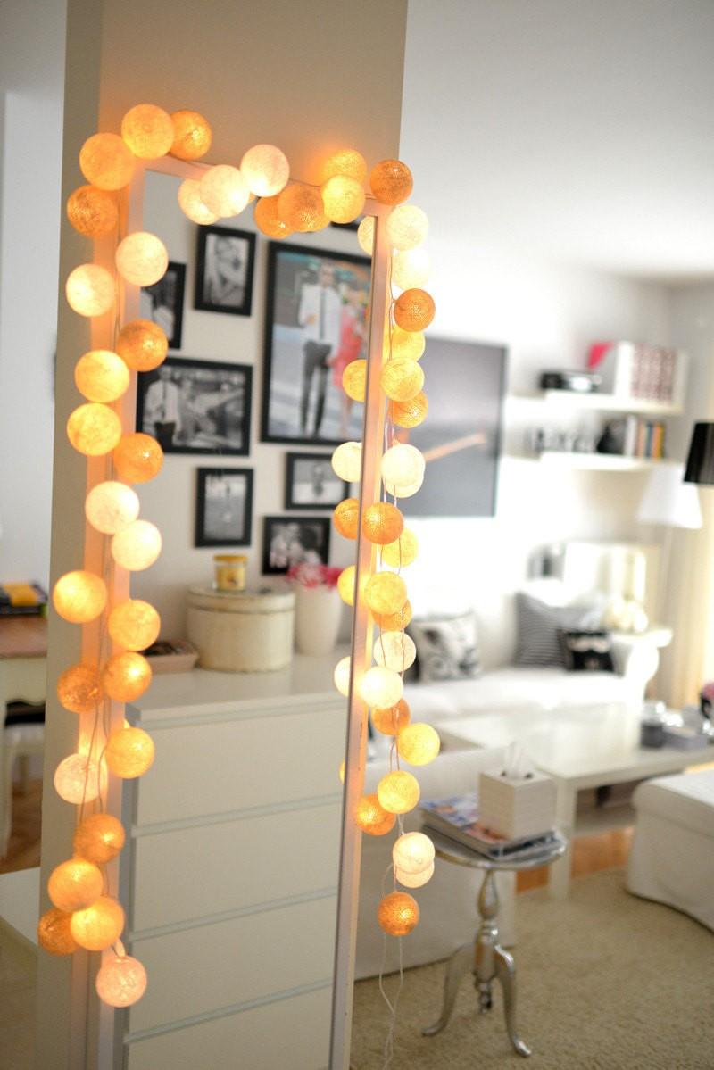 String lights draw attention to a tall mirror