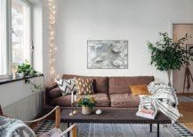 String-lights-illuminating-the-corner-of-the-living-room--217x155