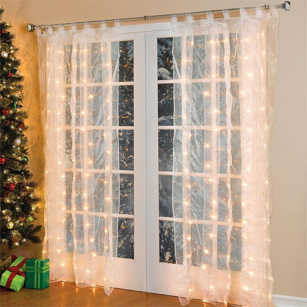 String lights illuminating the transparent curtains