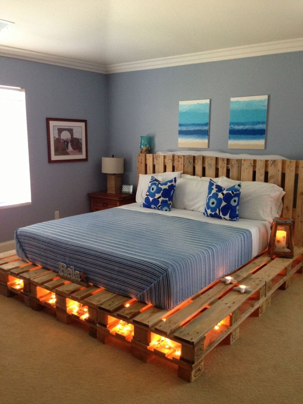 String lights in the bottom of the pallet bed frame