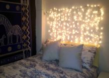 String-lights-in-the-place-of-a-headboard-217x155