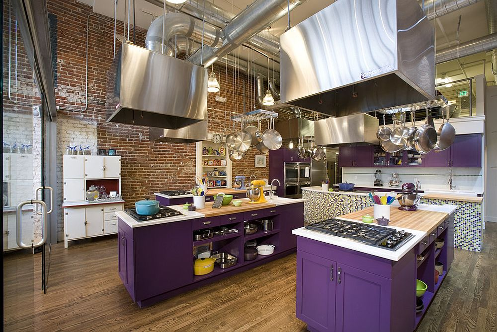 Stunning kitchen islands in purple bring dazzling color to the industrial space