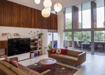 Sweeping-windows-and-glass-doors-connect-the-double-height-interior-with-the-view-outside-217x155
