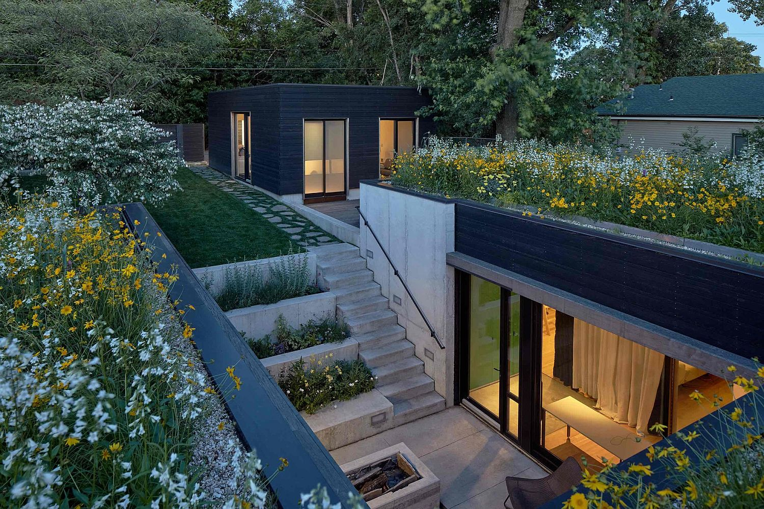 Transplanted prairie ecosystem hides the underground public spaces Concealed in a Shroud of Green: Steeping into the Shelton Marshall Residence!