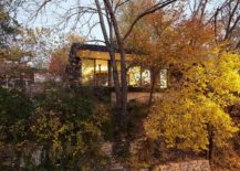 Trees-and-a-curated-garden-carefully-hide-the-house-from-street-view-217x155