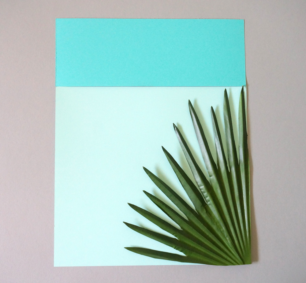 Try different arrangements of paper and palms