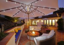 Umbrella-string-lights-lighting-up-the-lounging-area-217x155