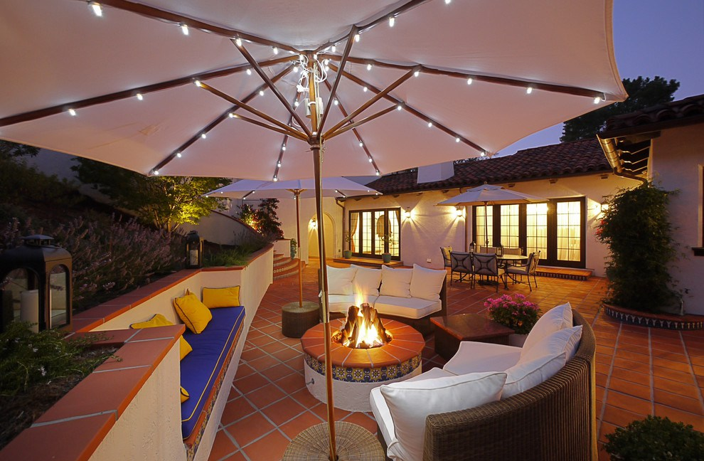 Umbrella string lights lighting up the lounging area