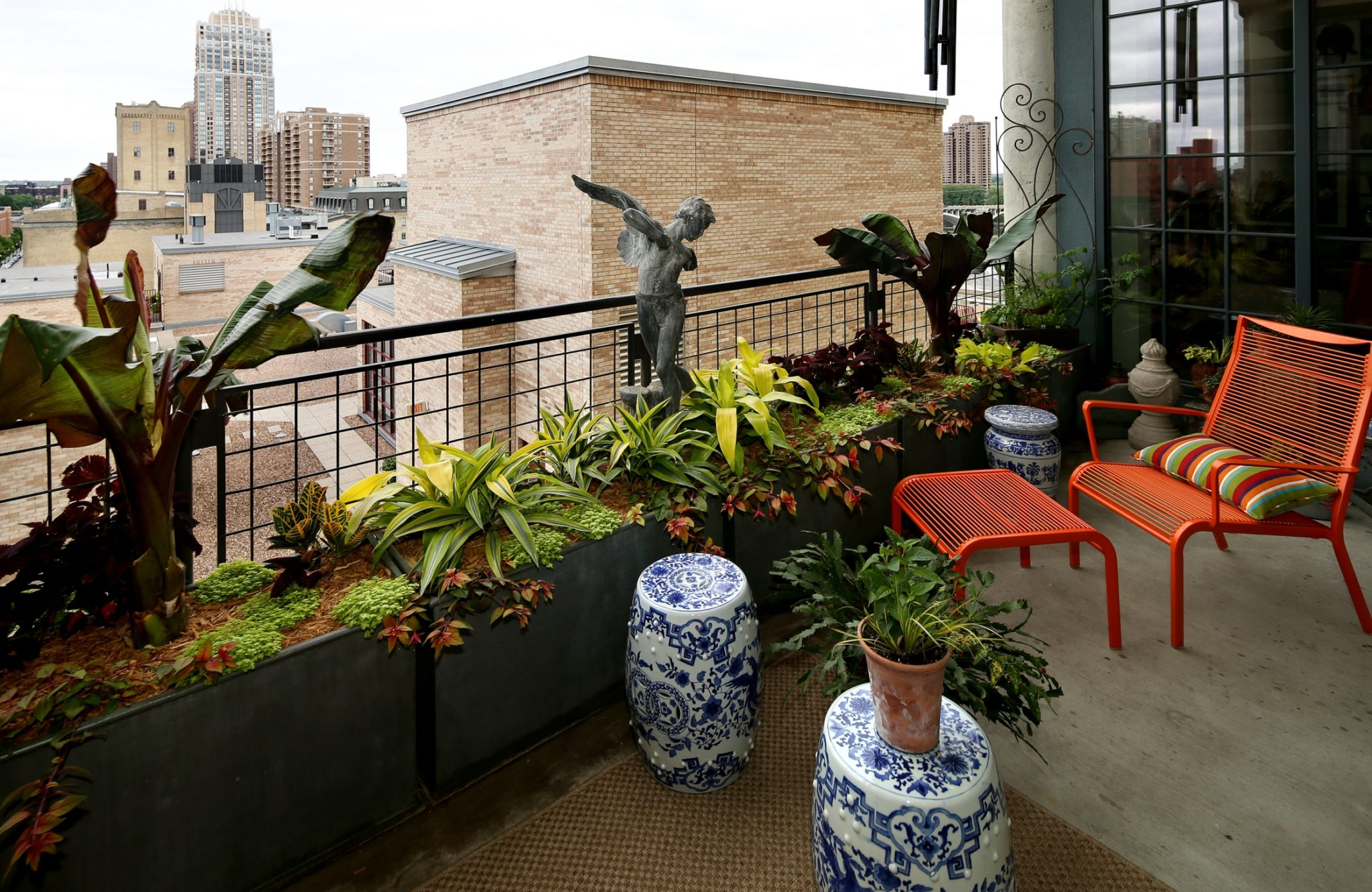 Urban balcony garden with matte raised planters