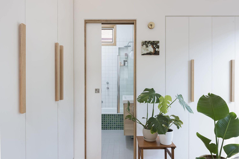 White-copper-and-green-create-a-refined-and-contemporary-interior