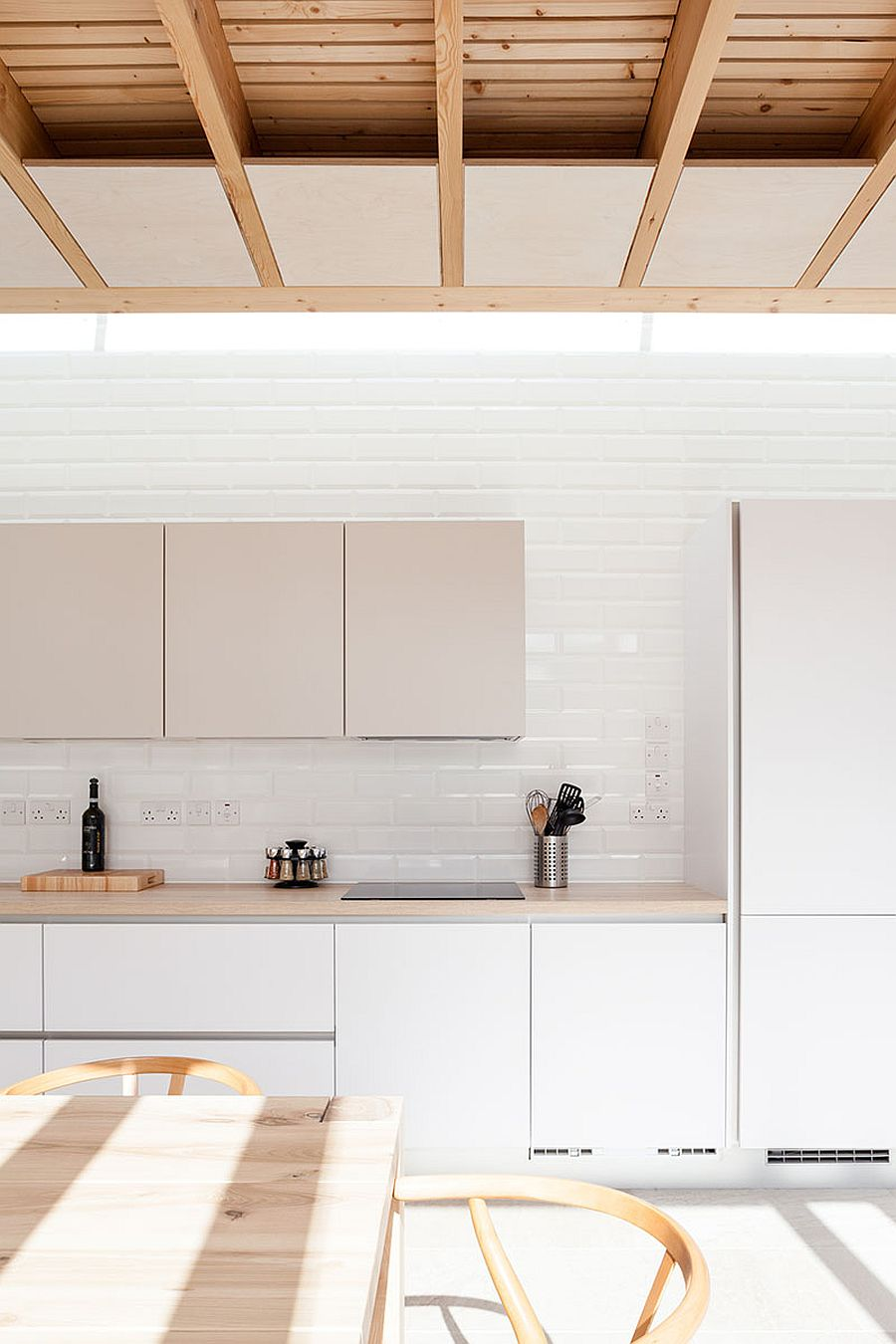 White kitchen and dining inside the contemporary extension of Dublin home