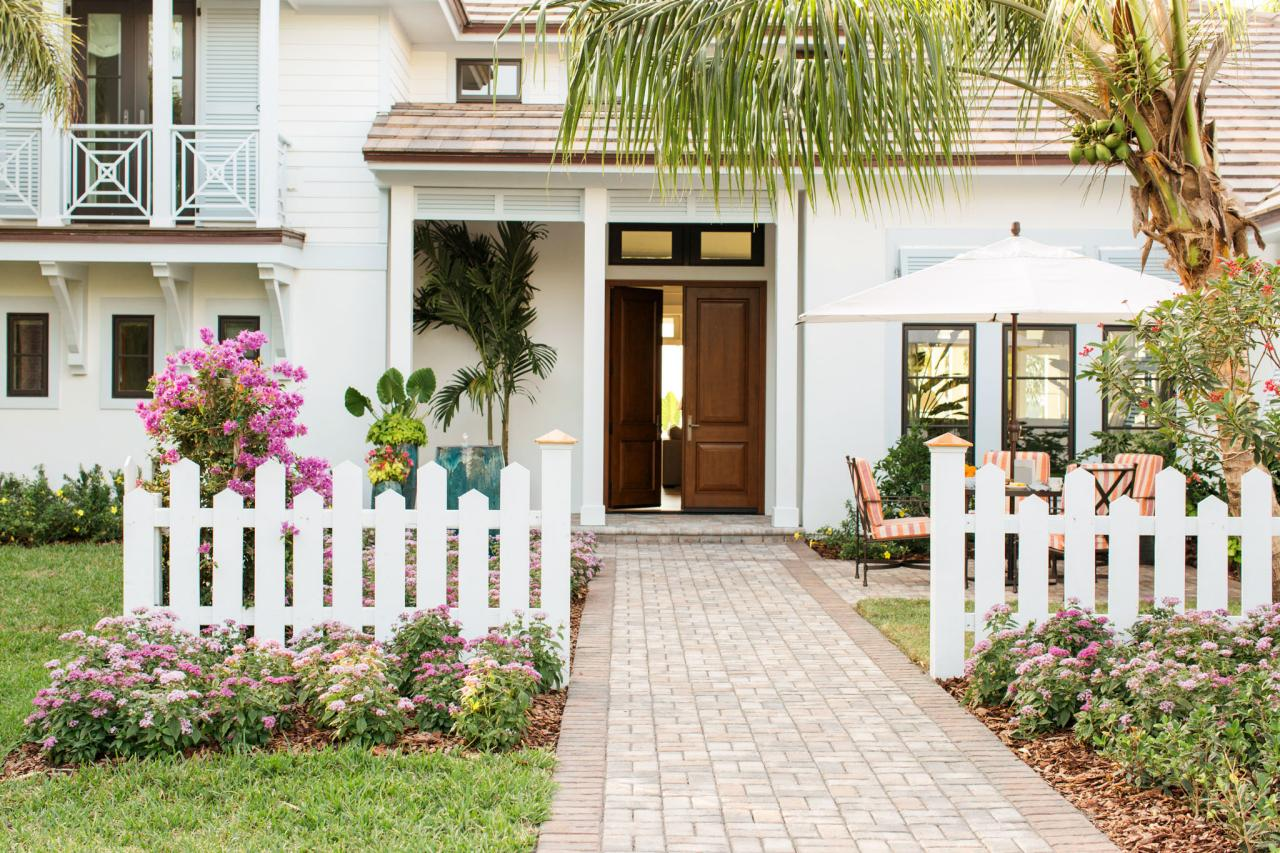 Wide white picket fence with a modern style