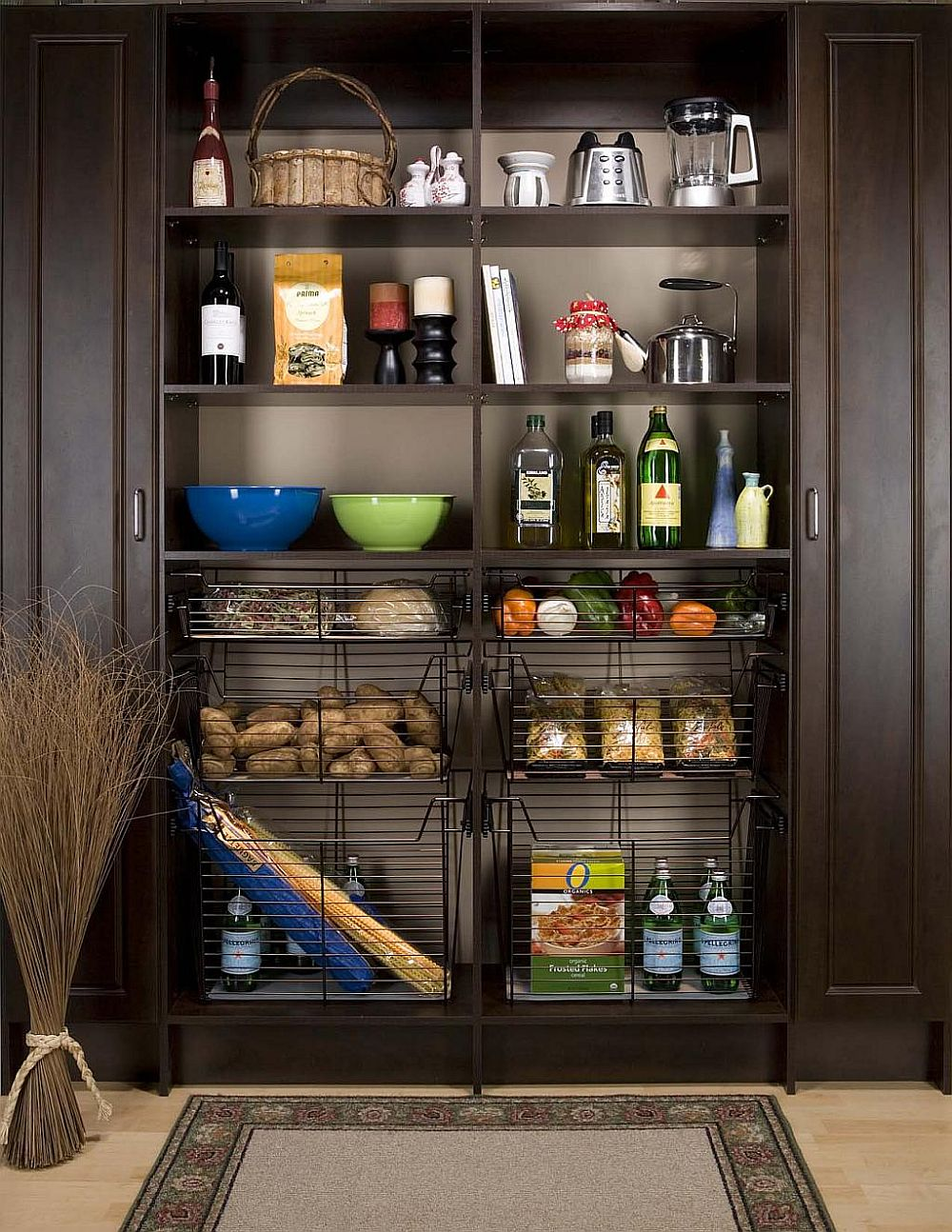 Wiry baskets bring additional storage space to the open pantry