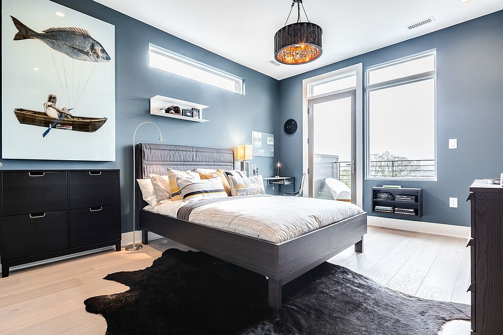 Wooden bedroom decor and the bed frame bring gray to this Scandinavian style bedroom in blue