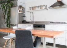 Wooden-dining-table-brings-textural-contrast-to-the-interior-217x155