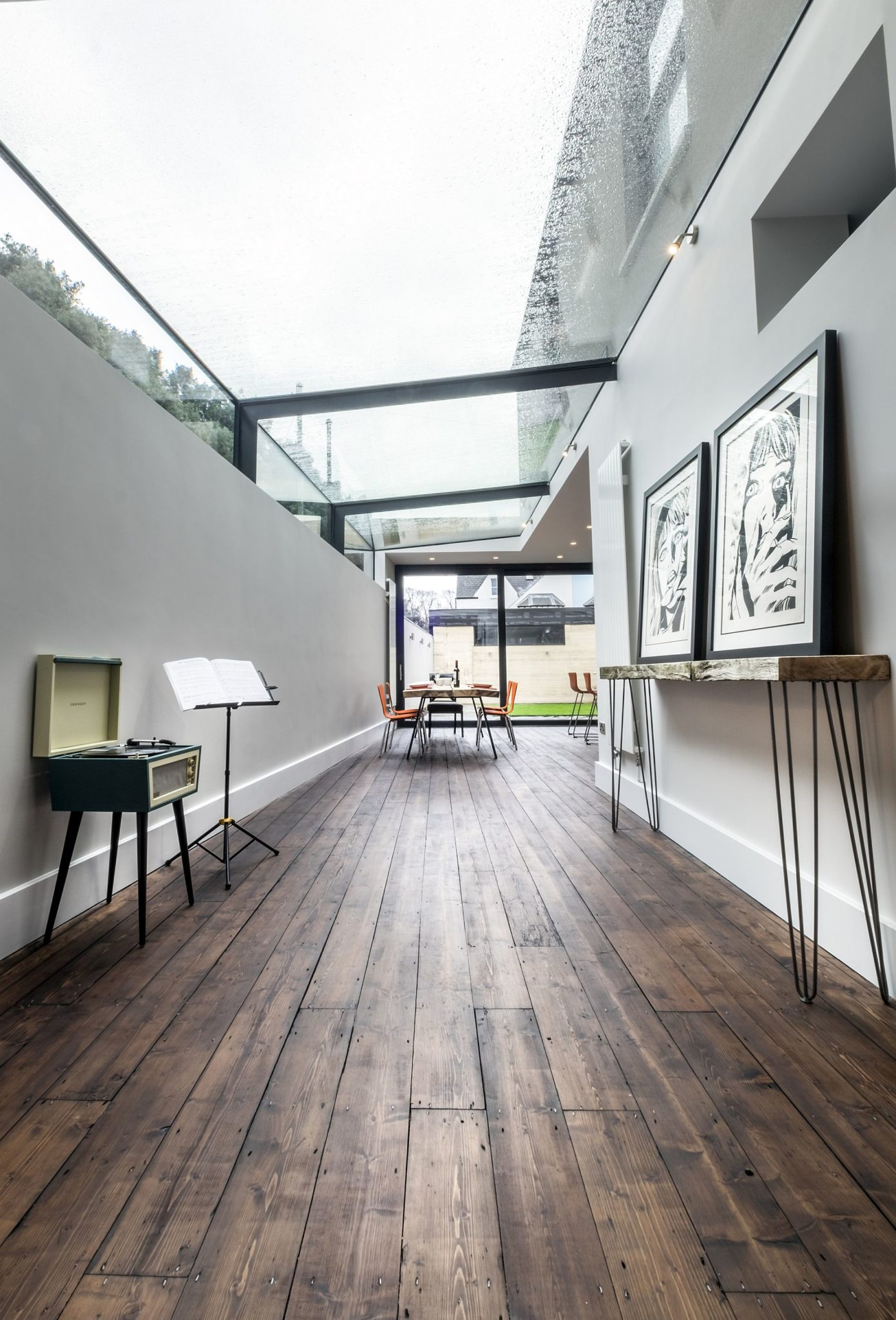 Modern Revamp Involving A Glass Roof Transforms This Dark