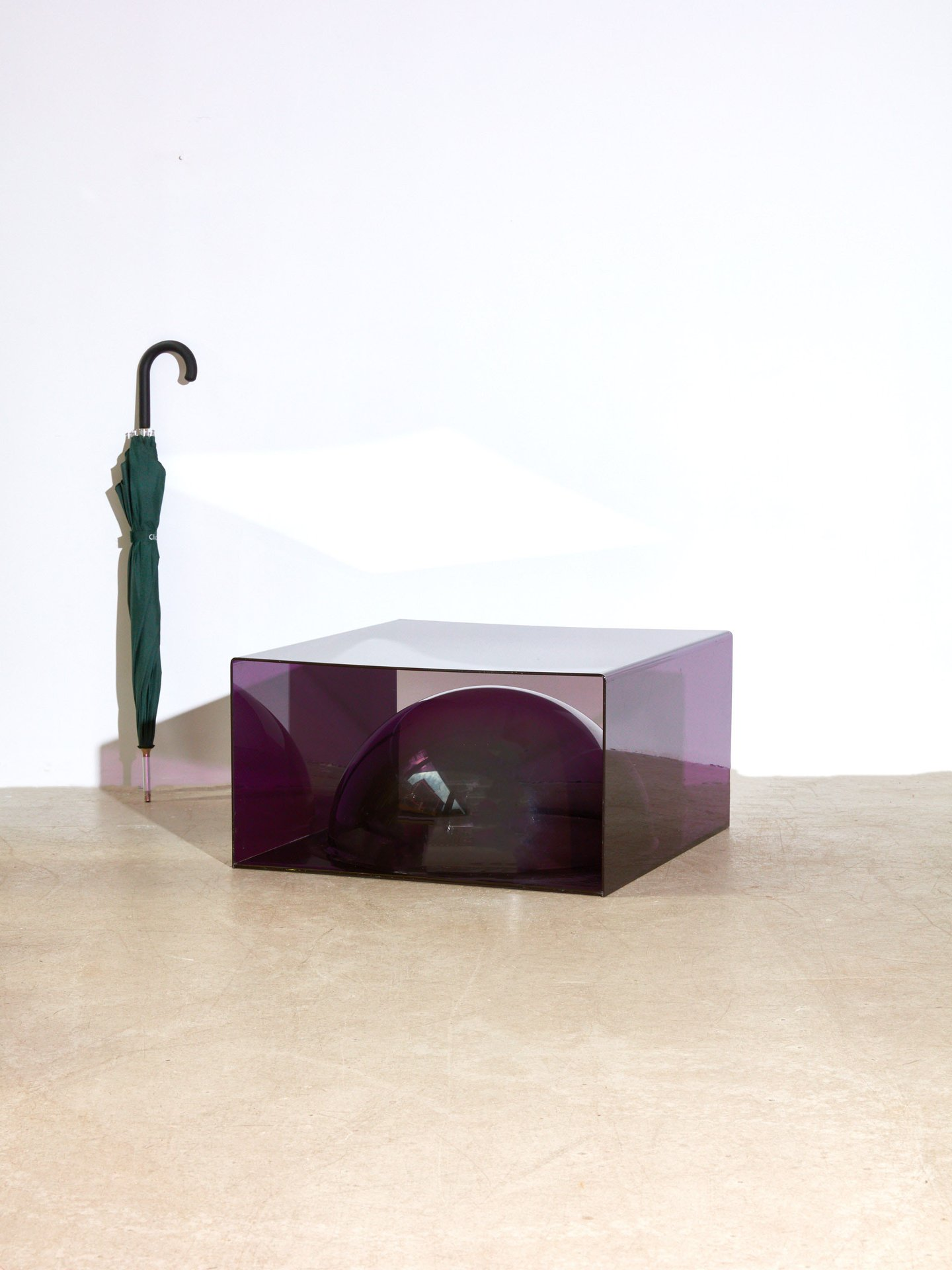 Acrylic purple table from Coming Soon
