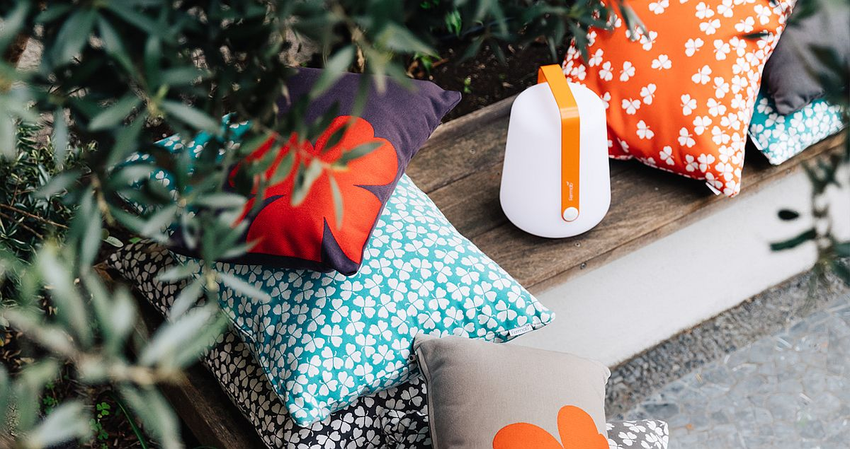 Balad-outdoor-lamp-along-with-Trefle-cushions-create-an-informal-outdoor-hangout