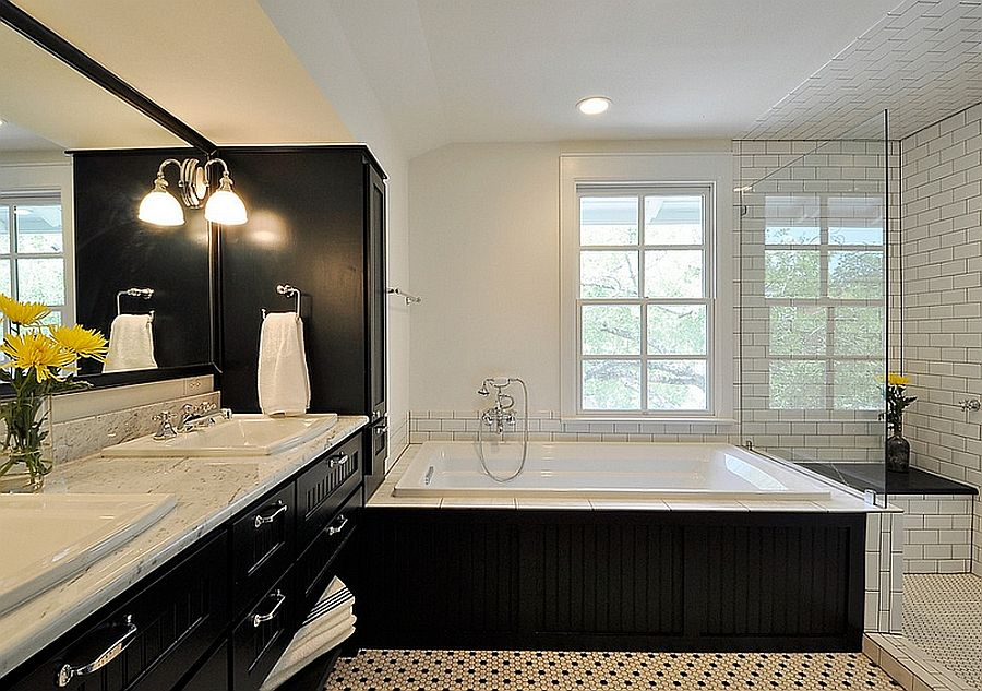 Bathtub, vanity and medicine cabinet in black present a picture of curated elegance in the bathroom