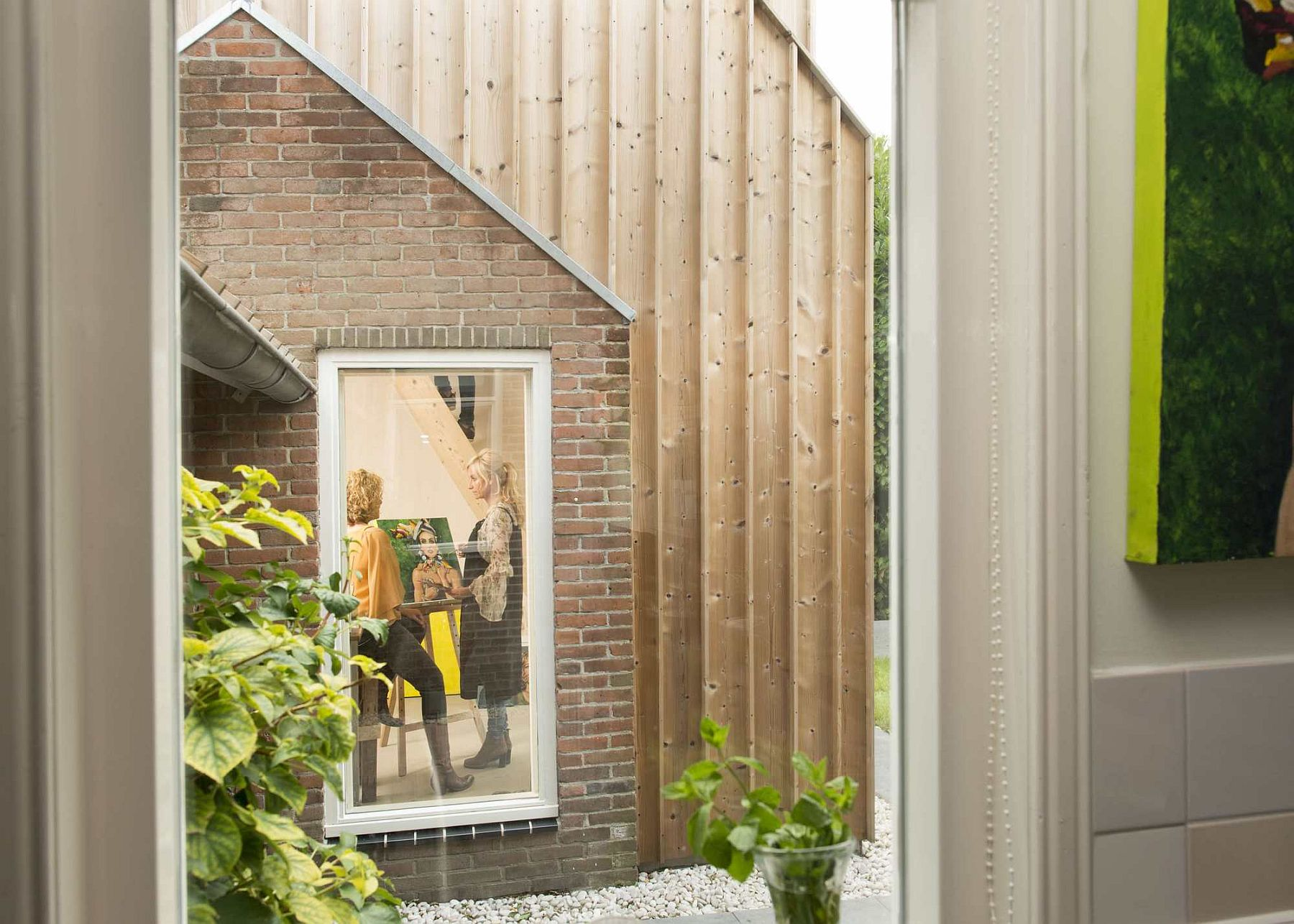 Beautifully framed windows add to the charm of the painting studio