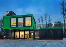 Black and green exterior of the Unit Cafe crafted using shipping containers 217x155 This Flamboyant Café in Kiev is Made out of 14 Shipping Containers!