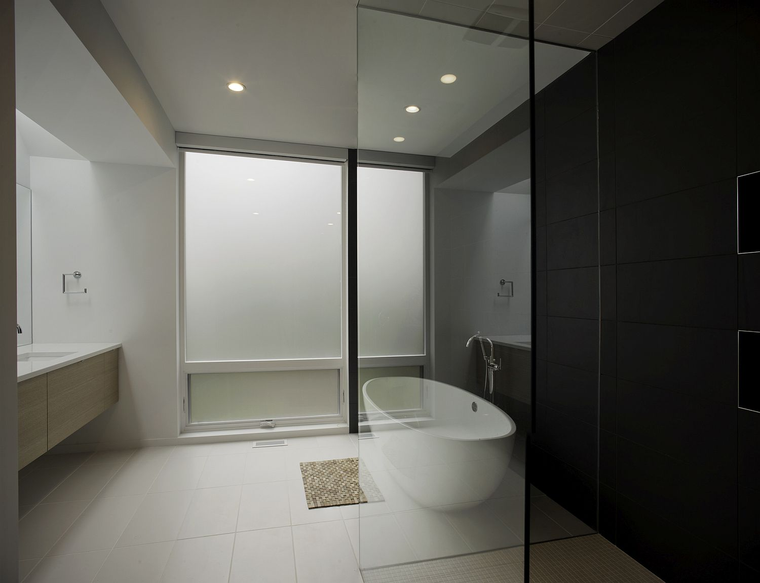Black and white minimal bathroom with floating wooden vanity