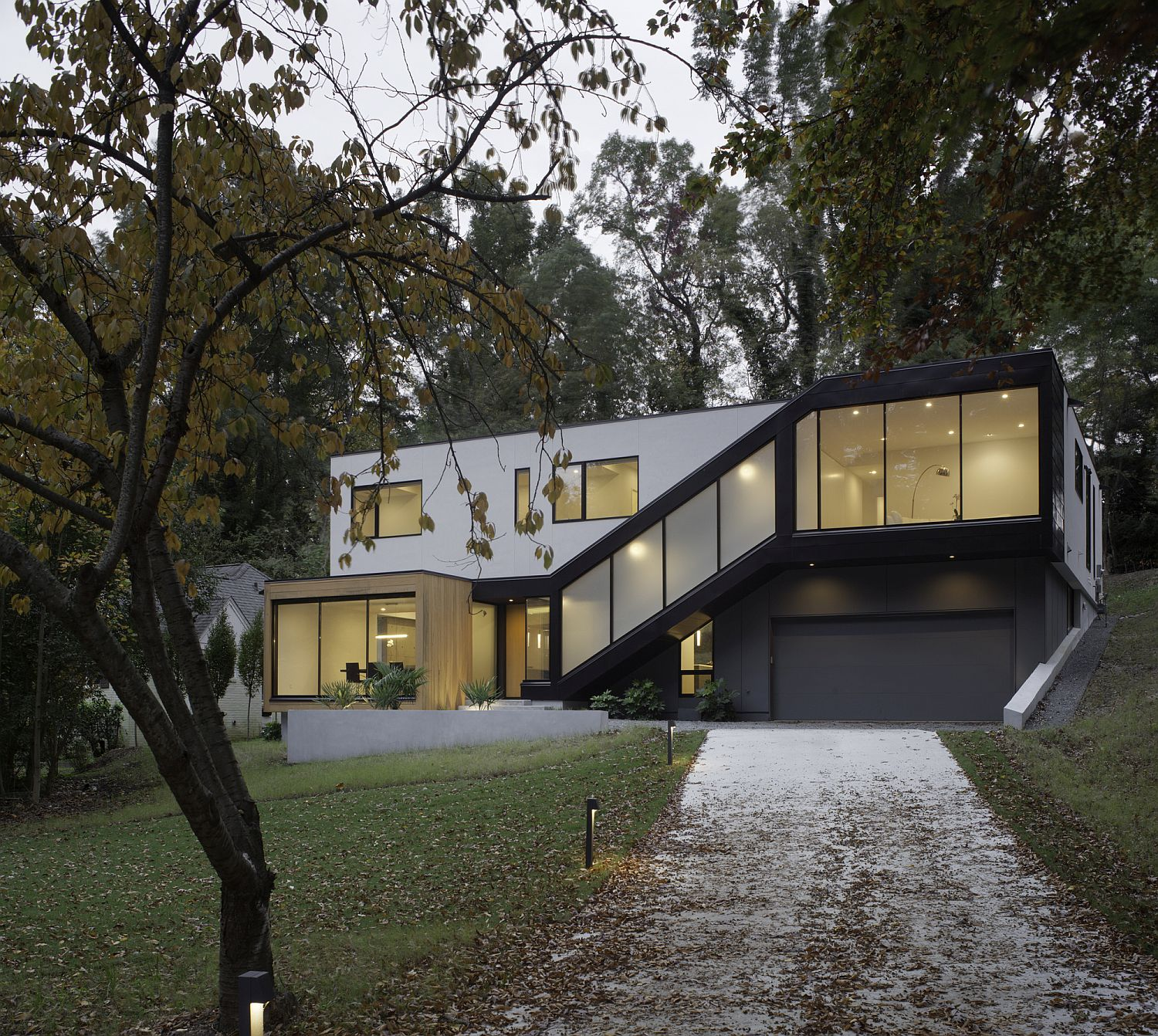 L Shaped Modern Minimal Residence On A Sloped Lot In Raleigh