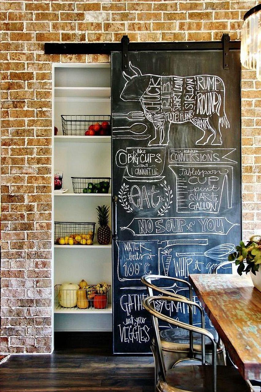 Chalkboard sliding wall next to brick walls creates a cool pantry