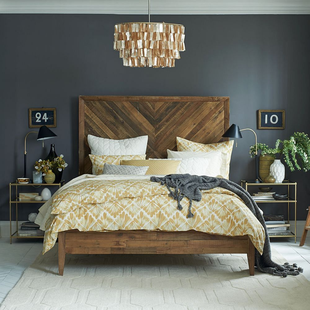 Chandelier steals the spotlight in this chic modern bedroom