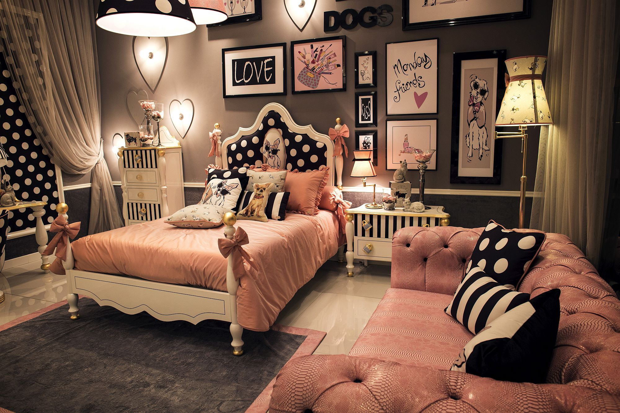 Chic teen bedroom in black and pink with matching lighting fixtures