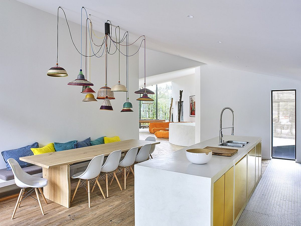 Colorful collection of pendants above the dining area