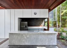 Concrete kitchen island is easy to maintain and clean 217x155 Screened Veranda Walled by a Rainforest Serves as a Serene Holiday Home