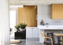 wood shelves accent concrete ceiling in kitchen