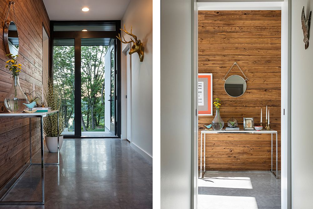 Entryway clad in wood with a slim console table