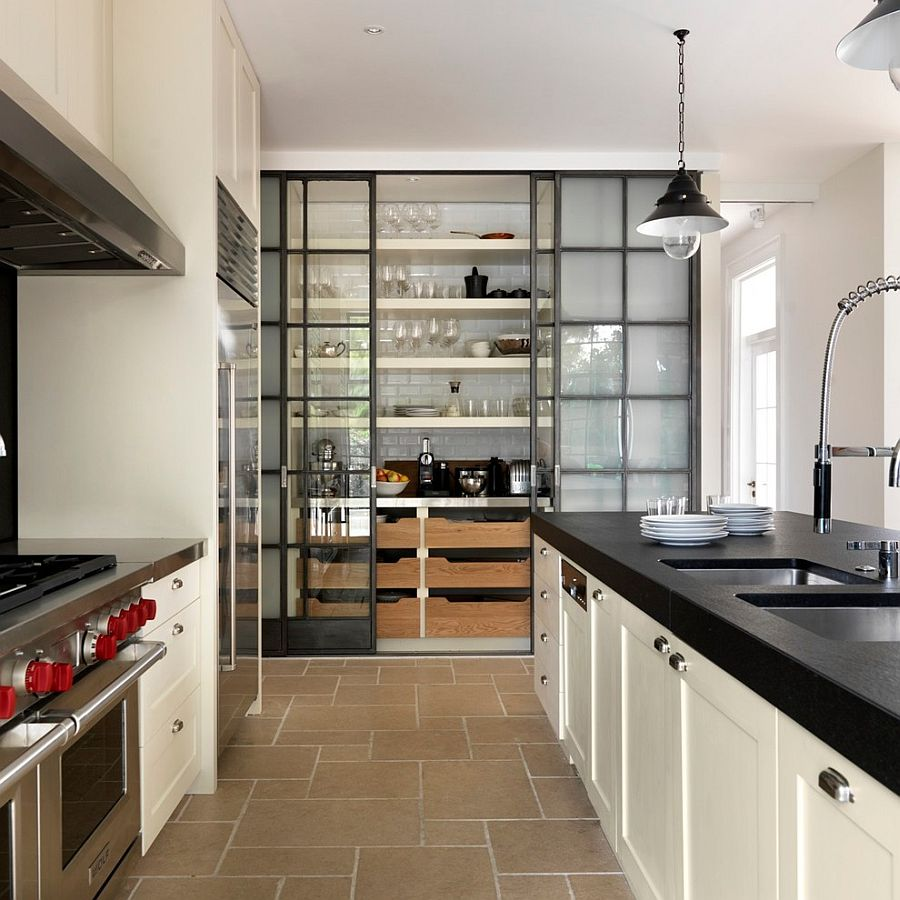 Expansive kitchen pantry with industrial style glass doors
