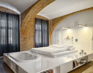 Modern Apartment of a Football Player Celebrates the Beauty of Brick Walls