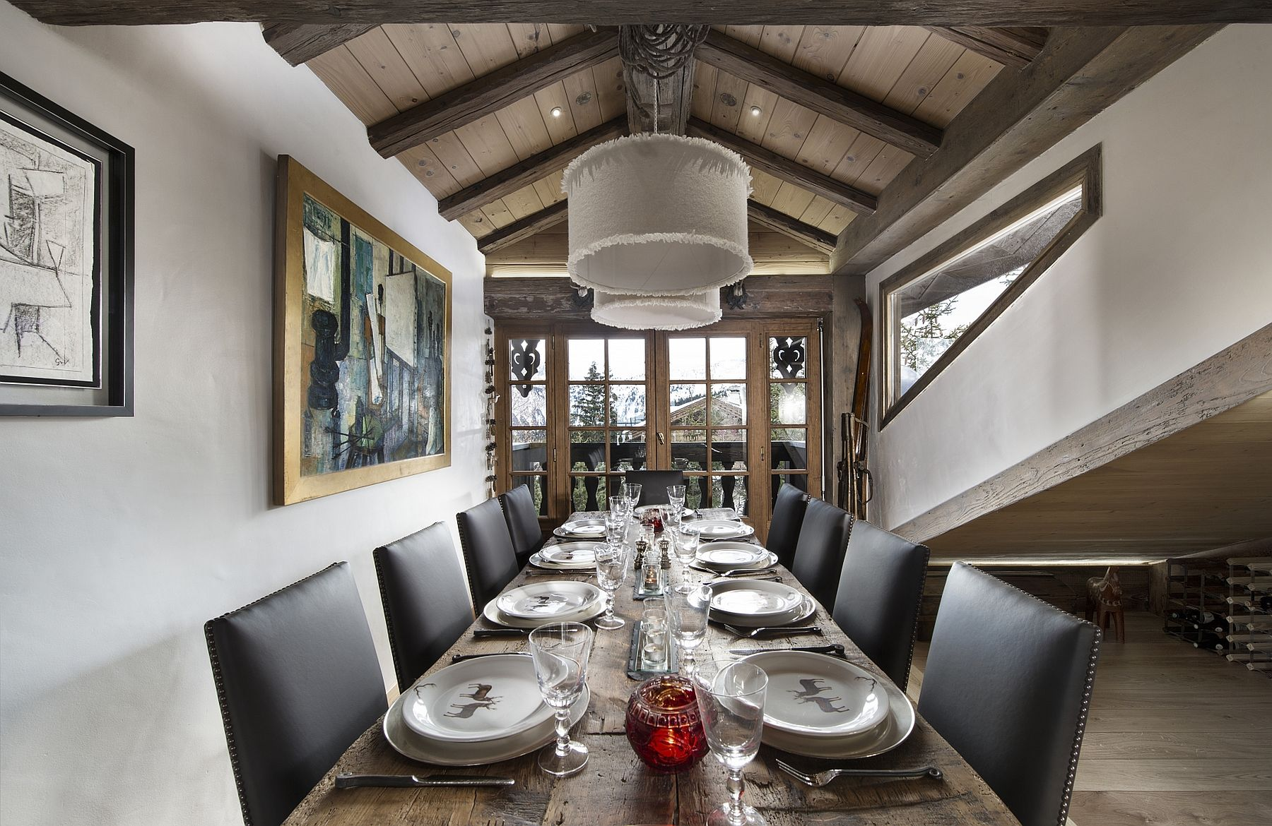 Formal dining room with majestic alpine views at luxurious Le Namaste