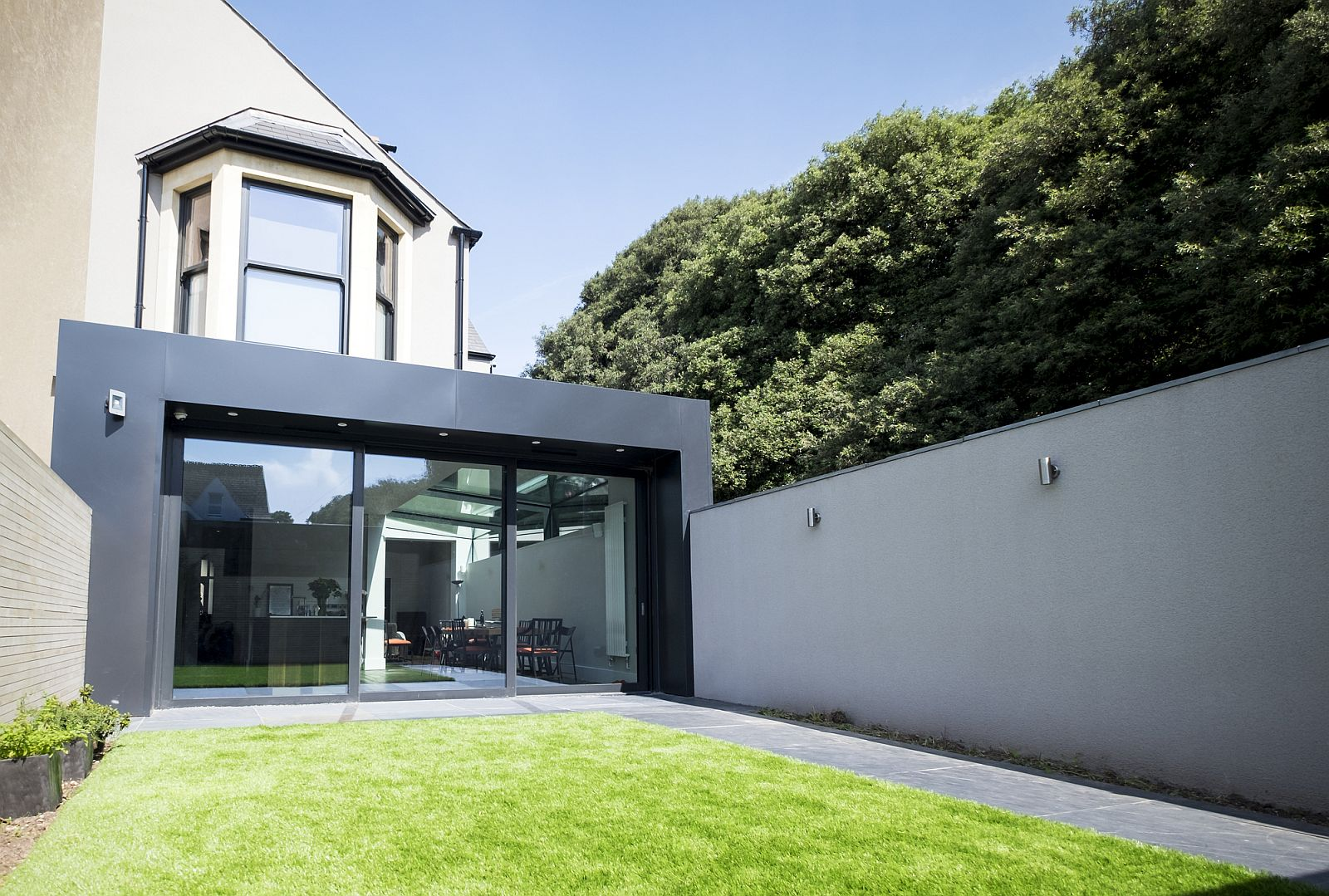Modern Revamp Involving a Glass Roof Transforms This Dark Victorian House