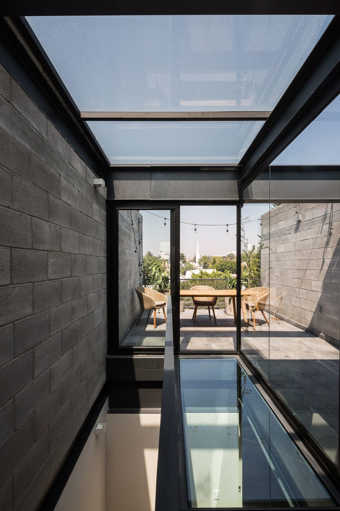 Concrete Steel And Glass Townhouses Invite In Minimalism