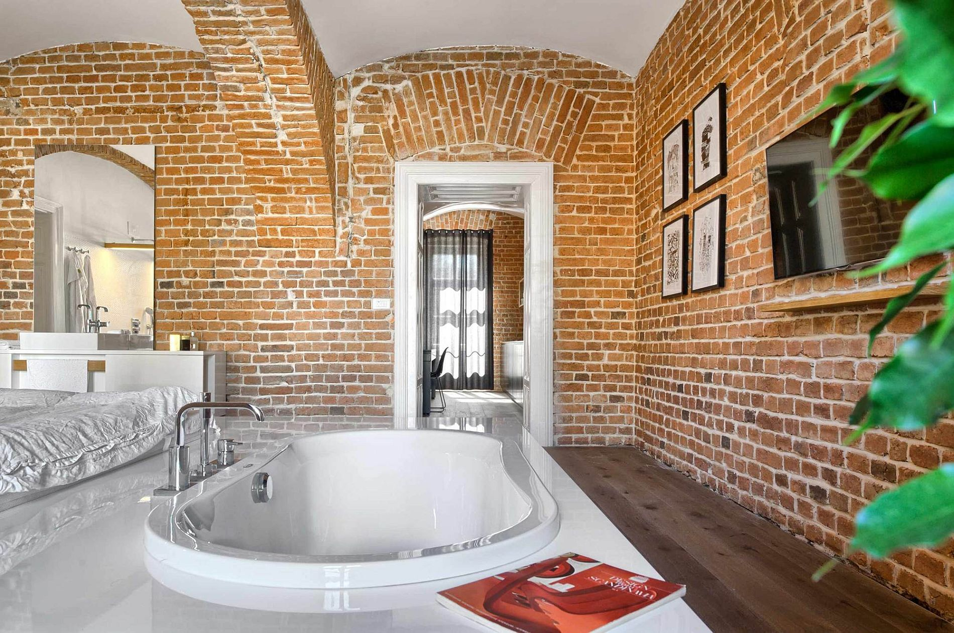 Gorgeous brick wall apartment designed for a footballer