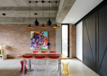 dining room with colorful painting and concrete ceiling