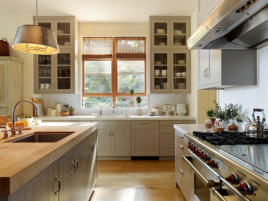 Gorgeous traditional kitchen with a custom island that features wooden countertop