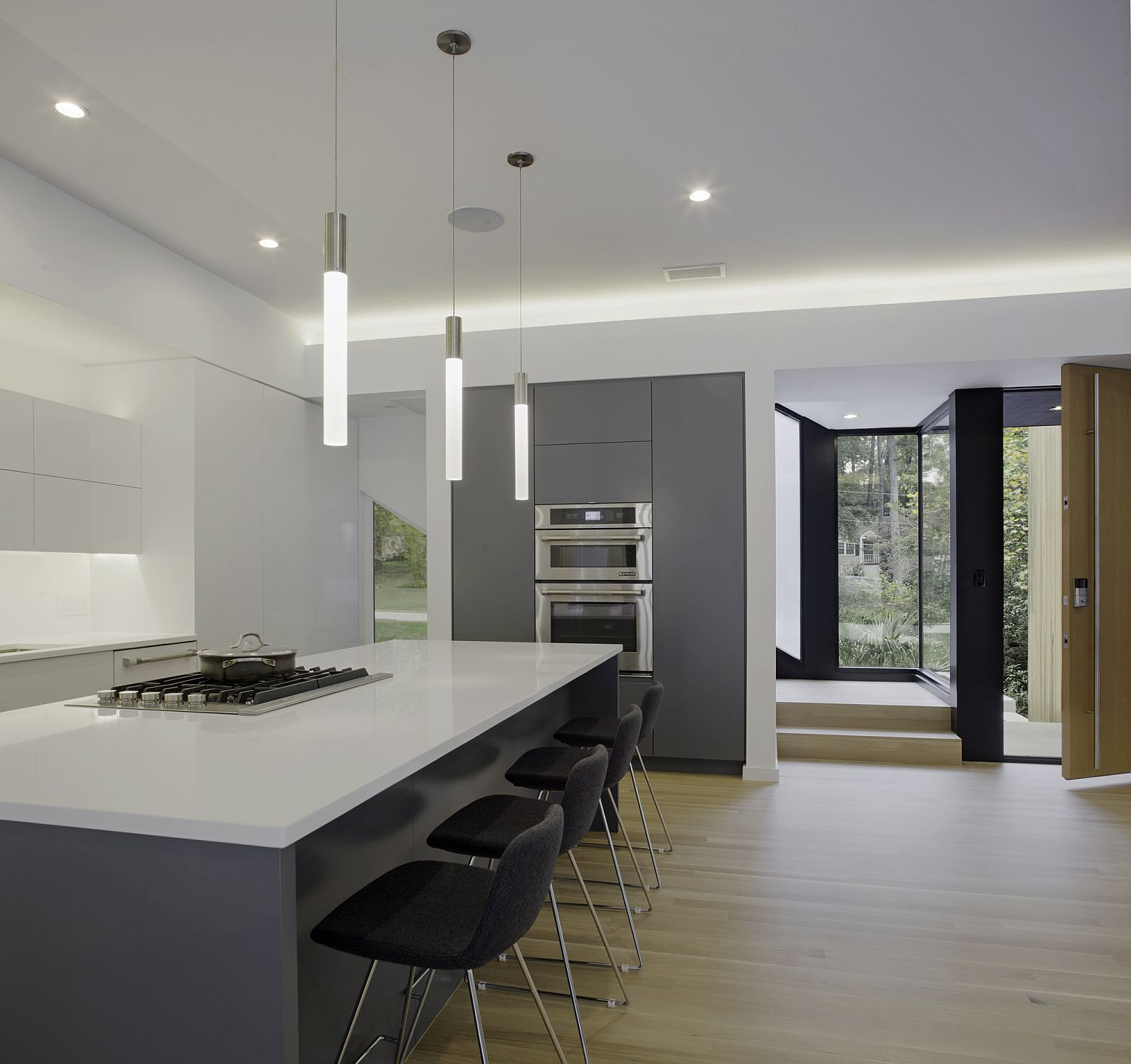 Gray and white kitchen with minimal pendant lights