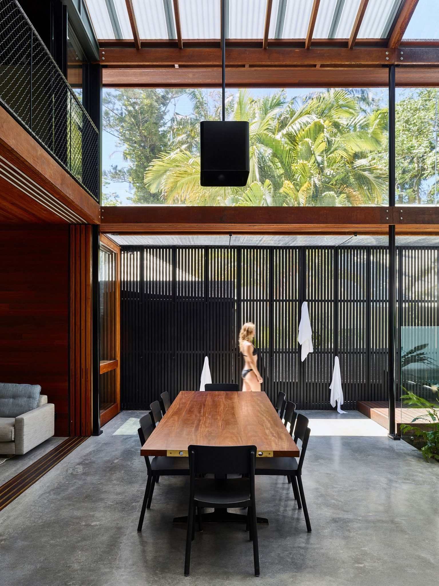 Greenery outside becomes a part of the open dining space