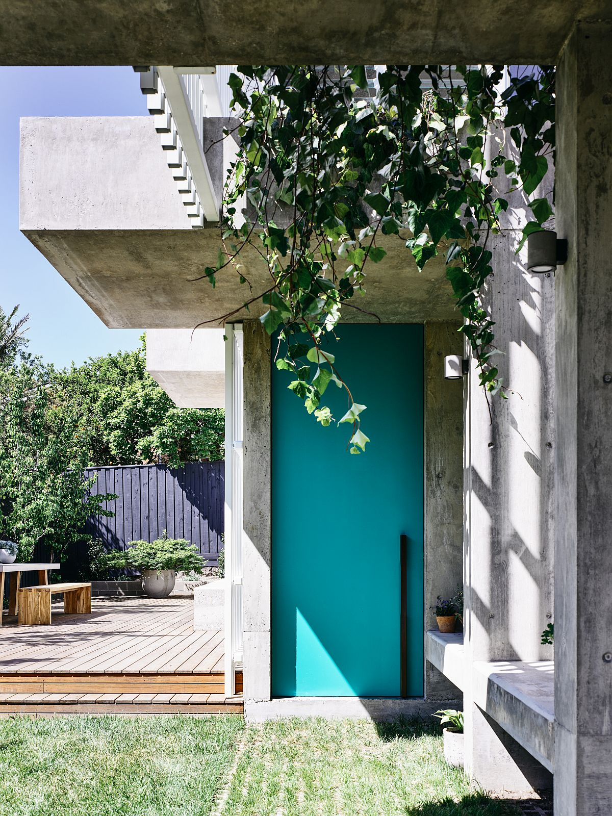 Hanging plants and grasscrete welcome you at this modern Kew Residence