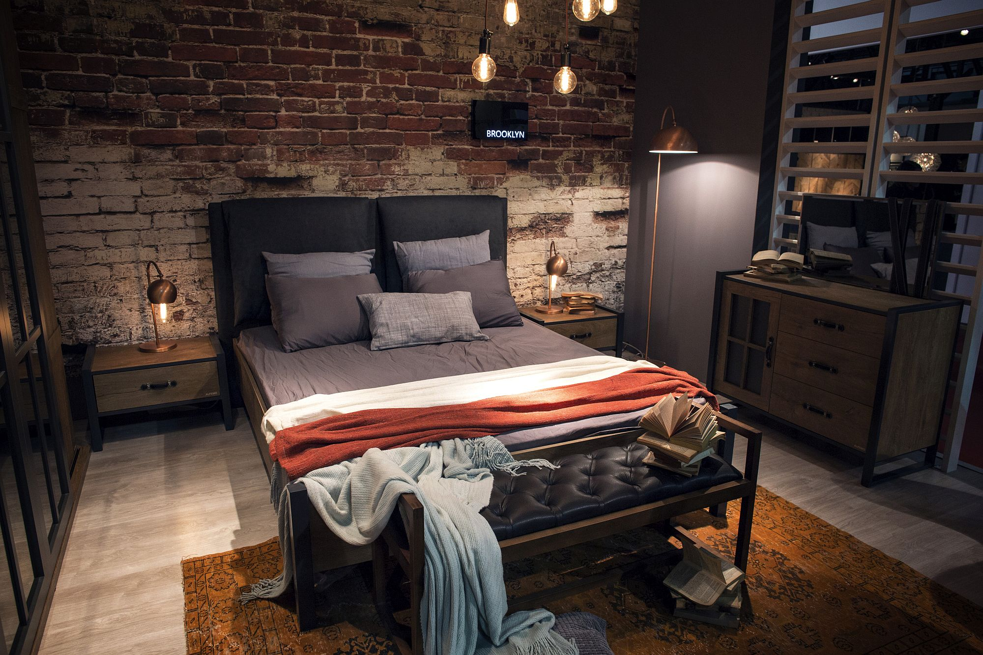 Industrial style bedroom with slim copper floor lamp next to the bed