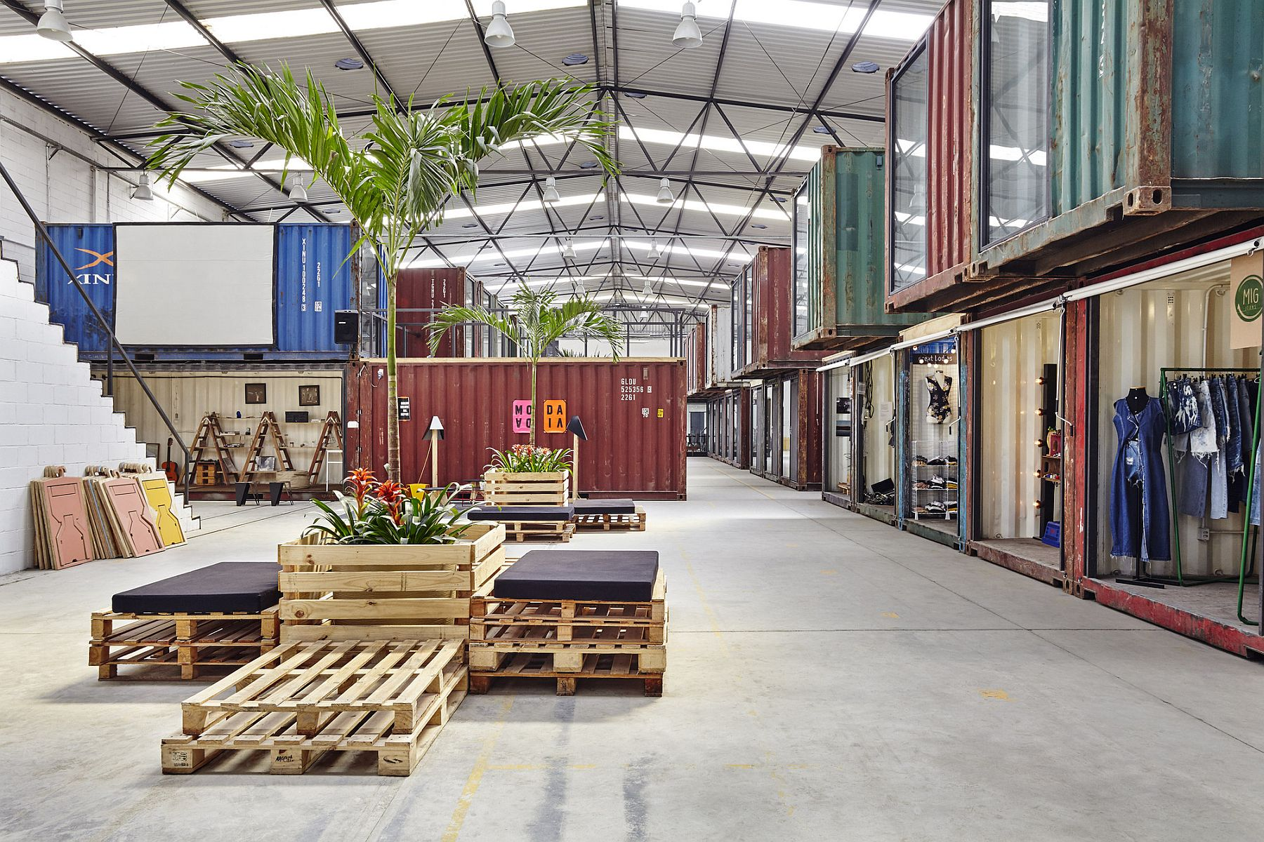 Large warehouse in Rio filled with repurposed containers creates new age trend in the fashion world 42 Repurposed Containers Inside a Warehouse Reshape Rio's Fashion Scene!