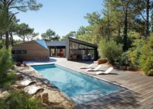 Large wooden deck and pool outside Cabane au Cap Ferret 217x155 This Polished Holiday Cabin Reflects Laid Back Spirit of Cap Ferret!