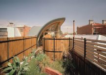 Large wooden fence helps create a green courtyard inside the Melbourne home 217x155 Contemporary Green House in Melbourne Also Ushers in Sustainable Style