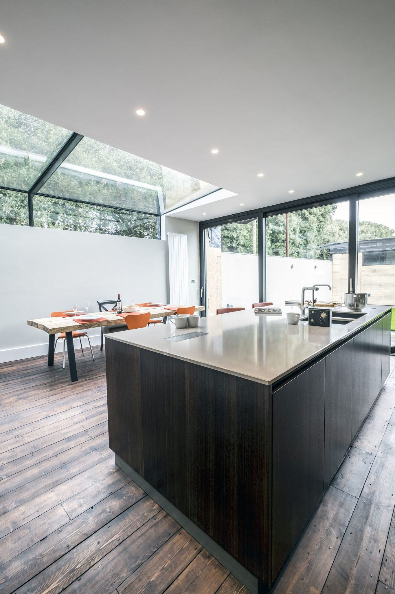 Light-filled kitchen and dining of the Victorian home in Eucalyptus wood and gray
